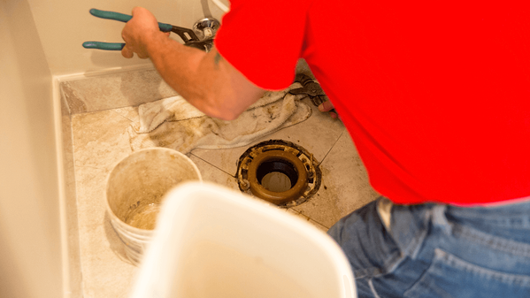 Why does my toilet rock back and forth_loose flange bolts_The Geiler Company